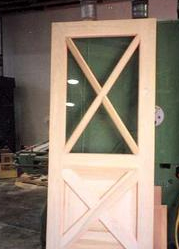 Exterior Door C/w Cross Carving Crossbuck Pattern With Flat Panels On  Bottom. Tempered Sealed Units In Crossbuck Pattern On Top.